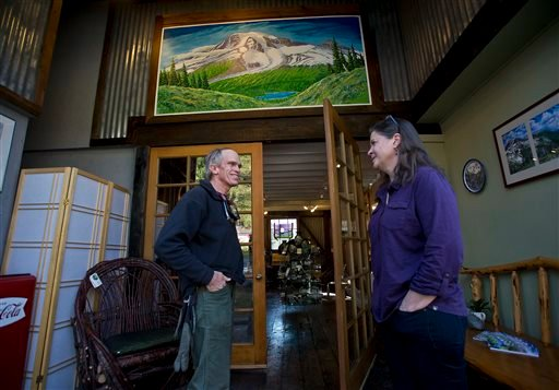 Furloughed park ranger Rich Lechleitner, left, visits with friend Jana Gardiner co-owner of Ashford Creek Pottery Tuesday Oct. 15, 2013 as Mount Rainier National Park in Washington remained closed. (AP Photo/The News Tribune, Dean J. Koepfler)