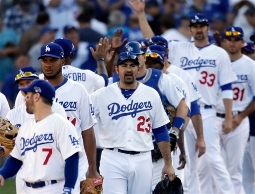 Los Angeles Dodgers' Adrian Gonzalez (23) celebrates with teammates after Game 5 of the National League baseball championship series against the St. Louis Cardinals, Wednesday, Oct. 16, 2013, in Los Angeles. (AP Photo/Chris Carlson)