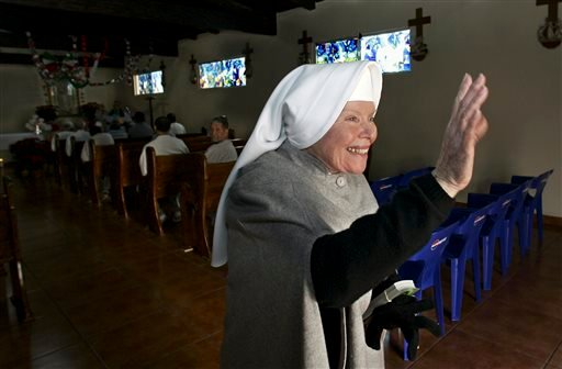 "In this Dec. 15, 2005 file photo, Sister Antonia Brenner, 79, known as the ""prison angel,"" waves as she leaves the chapel at the La Mesa State Penitentiary in Tijuana, Mexico. Brenner died Thursday Oct. 17, 2013 after a long illness. She was 86."