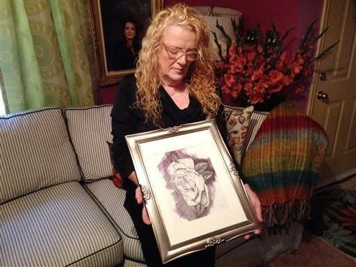On Friday, Oct. 18, 2013, Joyce Jackson holds a drawing made by her son Bobby Gerald Bennett, in Dallas.
