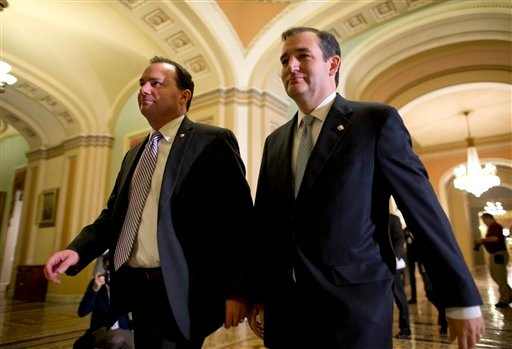 In this Oct. 16, 2013, photo, Sen. Mike Lee, R-Utah, left, and Sen. Ted Cruz, R-Texas, walk to the Senate floor to vote on a bill to raise the debt ceiling and fund the government on Capitol Hill in Washington.