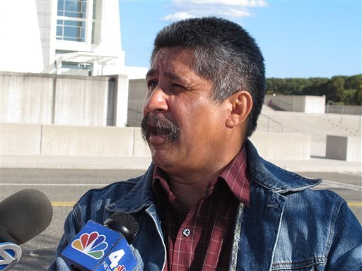 Albaro Zea speaks to reporters outside the U.S. District Courthouse in Central Islip, N.Y., following the arraignment of his son Marcos Alonzo Zea, on Friday, Oct. 18, 2013.