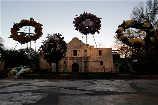In this March 6, 2013, file photo, wreaths are seen in front of the Alamo following a a pre-dawn memorial ceremony to remember the 1836 Battle of the Alamo and those who fell on both sides, in San Antonio.