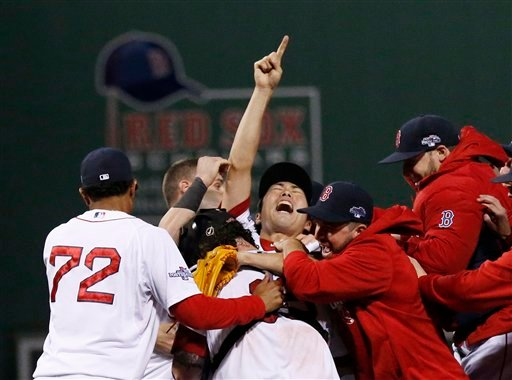 Boston Red Sox relief pitcher Koji Uehara, center, celebrates with teammates after the Red Sox 5-2 beat the Detroit Tigers in Game 6 of the American League baseball championship series on Saturday, Oct. 19, 2013, in Boston.