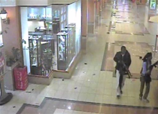 In this frame grab from surveillance video provided by Kenya Police via KTN, two gunmen wander through the Westgate Mall, Sept. 21, 2013, in Nairobi, Kenya.