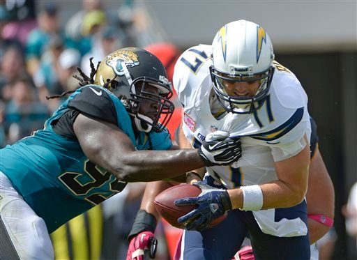 Jacksonville Jaguars defensive tackle Sen'Derrick Marks, left, sacks San Diego Chargers quarterback Philip Rivers (17) during the first half of an NFL football game in Jacksonville, Fla., Sunday, Oct. 20, 2013.(AP Photo/Phelan M. Ebenhack)