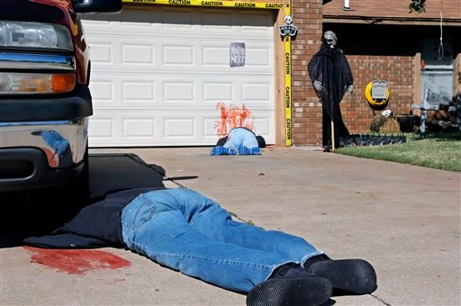 A photo shows Johnnie Mullins' controversial Halloween display featuring headless dummies dressed in his work clothes at his home in Mustang, OK.