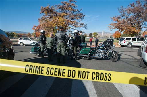 Police secure the scene near Sparks Middle School after a shooting in Sparks, Nev., on Monday, Oct. 21, 2013. Authorities are reporting that two people were killed and two wounded at the Nevada middle school. (AP Photo/Kevin Clifford)