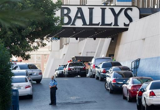 Las Vegas Metro Police cars and a hotel security officer are shown in front of Bally's hotel-casino after an early morning shooting left one person killed and two wounded in Drai's, a nightclub inside Bally's, in Las Vegas, Monday, Oct. 21, 2013.