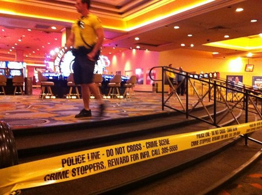 Security personnel cordon off the scene of an early morning shooting at Bally's Hotel-Casino on the Las Vegas Strip on Monday, Oct. 21, 2013.