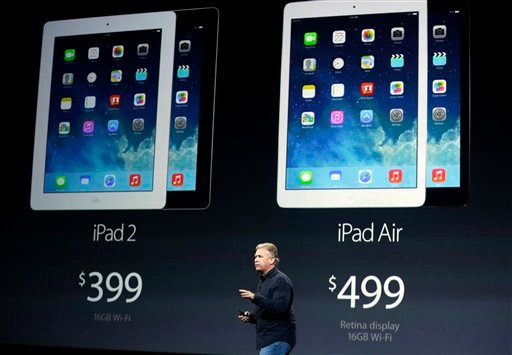 Phil Schiller, Apple's senior vice president of worldwide product marketing, introduces the new iPad Air on Tuesday, Oct. 22, 2013, in San Francisco. (AP Photo/Marcio Jose Sanchez)