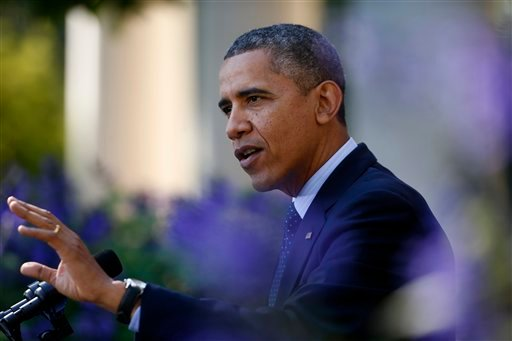 President Barack Obama gestures while speaking in the Rose Garden of the White House in Washington, Monday, Oct. 21, 2013, on the initial rollout of the health care overhaul.