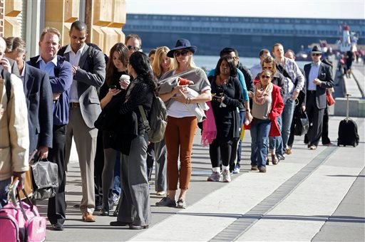 With the BART transit system on strike, people line up along the Embarcadero near the Ferry Building to catch a ferry to Oakland, Calif., during the afternoon commute Monday, Oct. 21, 2013, in San Francisco.