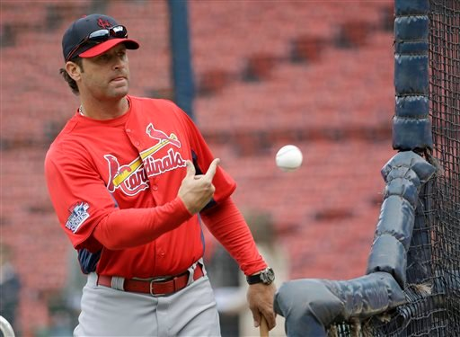 St. Louis Cardinals manager Mike Matheny tosses a ball during batting practice for Game 1 of baseball's World Series against the Boston Red Sox Tuesday, Oct. 22, 2013, in Boston.