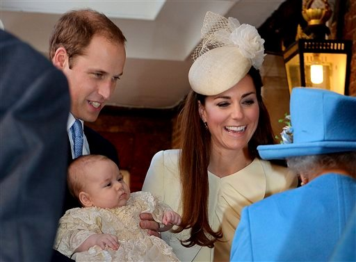 Britain's Queen Elizabeth II, right, speaks with Prince William and Kate Duchess of Cambridge as they arrive with their son Prince George at the Chapel Royal in St James's Palace, Wednesday Oct. 23, 2013.