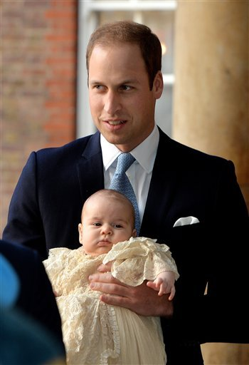Britain's Prince William, holds his son Prince George as they arrive at Chapel Royal in St James's Palace in London, for the christening of the three month-old Prince Wednesday Oct. 23, 2013.