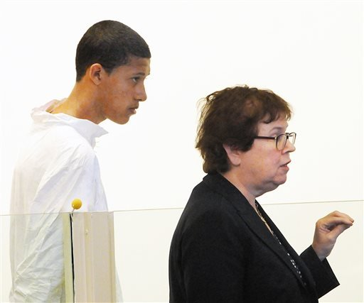 Philip Chism, 14, stands during his arraignment for the death of Danvers High School teacher Colleen Ritzer as his attorney Denise Regan speaks on his behalf. (AP Photo/Boston Herald, Patrick Whittemore)