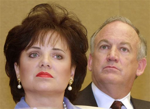 In this May 24, 2000 file photo, Patsy Ramsey and her husband, John, parents of JonBenet Ramsey, look on during a nws conference in Atlanta regarding their lie-detector examinations for the murder of their daughter.