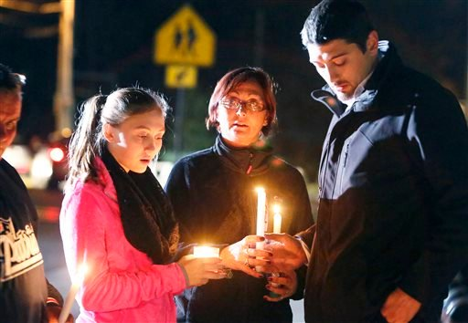 Parents and Danvers High School students hold candlelight vigil to mourn the death of Colleen Ritzer, a 24-year-old math teacher at Danvers High School, on Wednesday, Oct 23, 2013, in Danvers, Mass.