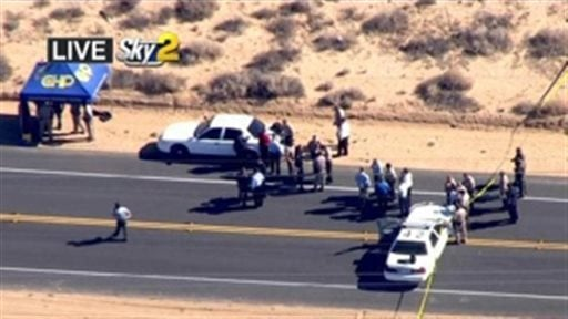 This video image provided by KCBS-TV shows the site of s shooting Friday Oct. 25, 2013 ion Ridgecrest, Calif.