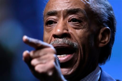 This July 26, 2013 file photo shows the Rev. Al Sharpton gestures as he takes part in a panel discussion during the National Urban League's annual conference in Philadelphia.