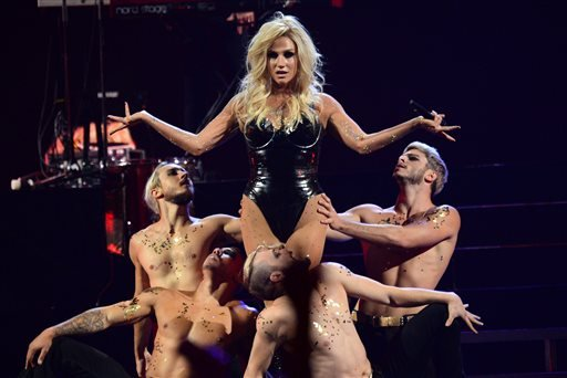 In this Sep. 22 2013 file photo, Ke$ha performs at the IHeartRadio Music Festival, in Las Vegas.