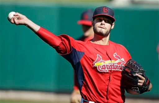 St. Louis Cardinals pitcher Joe Kelly warms up during baseball practice on Friday, Oct. 25, 2013, in St. Louis. The Cardinals and the Boston Red Sox are set to play Game 3 of the World Series, Saturday in St. Louis. (AP Photo/Charlie Neibergall)