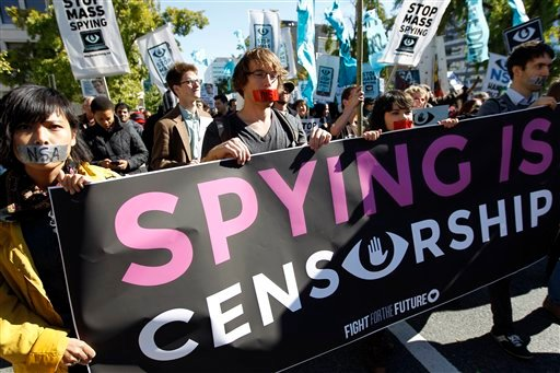 Demonstrators March through Washington towards the National Mall to rally and demand that the U.S. Congress investigate the National Security Agency's mass surveillance programs Saturday, Oct. 26, 2013. ( AP Photo/Jose Luis Magana)