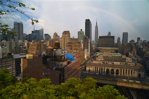 In this July 20, 2013, a rainbow appears in the New York skyline over the Empire State Building after a light rain lowered the over 90 degree city temperatures.