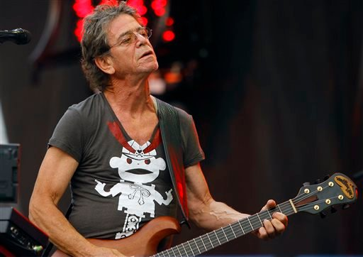 In this Sunday, Aug. 9, 2009 file photo, Lou Reed performs at the Lollapalooza music festival, in Chicago. Punk-poet, rock legend Lou Reed is dead of a liver-related ailment, his literary agen said Sunday, Oct. 27, 2013. He was 71.