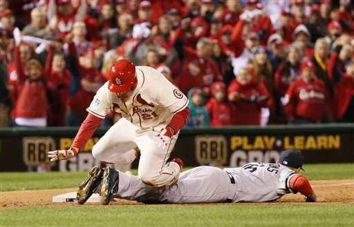St. Louis Cardinals' Allen Craig trips over Boston Red Sox third baseman Will Middlebrooks as he tries to score from third in the ninth inning during Game 3 of the World Series between the St. Louis Cardinals and the Boston Red Sox on Saturday, Oct. 26.