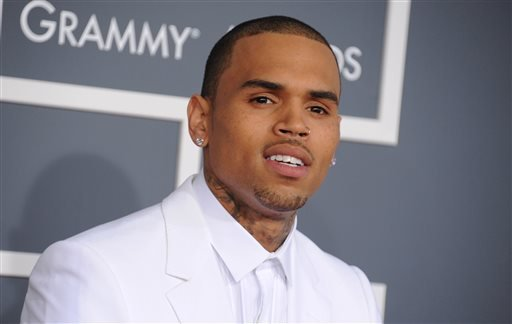In this Feb. 10, 2013 file photo, Chris Brown arrives at the 55th annual Grammy Awards, in Los Angeles.