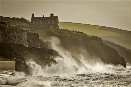 Waves crash onto the cliffs surrounding Porthleven, Cornwall, southwest England, Sunday, Oct. 27, 2013.