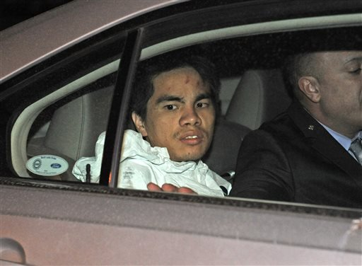 Mingdong Chen, a suspect in the murder of a five people in Brooklyn's Sunset Park neighborhood, is taken by police from the 66th precinct, Sunday, Oct. 27, 2013 in New York.