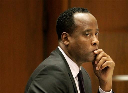 In this Friday, Oct. 21, 2011, file photo, Michael Jackson's former doctor Conrad Murray sits in a courtroom during his involuntary manslaughter trial in Los Angeles.