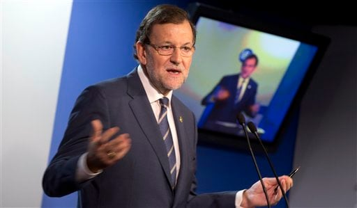 Spanish Prime Minister Mariano Rajoy gestures while speaking during a media conference after an EU summit in Brussels on Friday, Oct. 25, 2013.