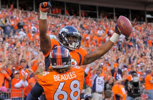 Denver Broncos wide receiver Demaryius Thomas (88) celebrates with guard Zane Beadles (68) after scorning a touchdown against the Washington Redskins in the fourth quarter of an NFL football game, Sunday, Oct. 27, 2013, in Denver. (AP Photo/Jack Dempsey)