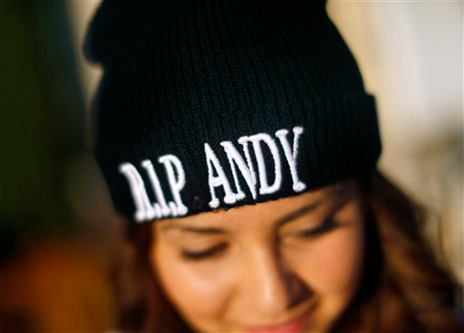 Esmeralda Mendoza, 14, wears a beanie with honoring her classmate Andy Lopez during a funeral service and viewing for Lopez at the Windsor-Healdsburg Mortuary on Sunday, Oct. 27, 2013. (AP Photo/The Press Democrat, Conner Jay)
