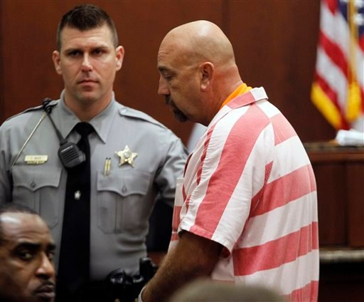 Ride operator Timothy Tutterrow, right, leaves court after he makes his first appearance in a Wake County Courtroom in Raleigh, N.C. on Monday, Oct. 28, 2013. (AP)