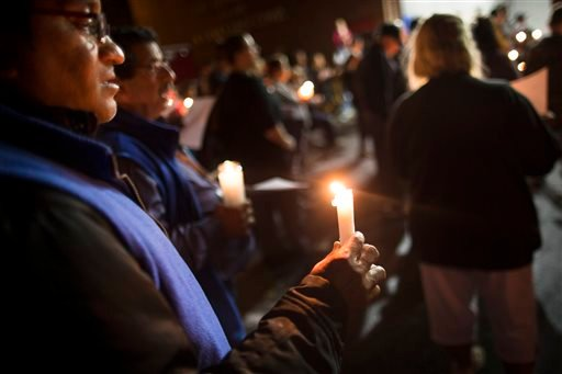 Residents attend a candlelight vigil at the West Hamilton Beach Volunteer Fire Department to commemorate the one-year anniversary of Superstorm Sandy, Monday, Oct. 28, 2013, in the Queens borough of New York. U.S.