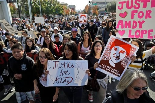 Protesters march on Tuesday, Oct. 29, 2013, in Santa Rosa, Calif. Hundreds of people have gathered in Santa Rosa to protest the fatal shooting of a 13-year-old boy by a California sheriff's deputy. (AP)