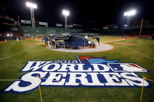 Grounds crew members dismantle the batting cage after the Boston Red Sox's workout at Fenway Park in Boston, Tuesday, Oct. 29, 2013. (AP Photo/Elise Amendola)