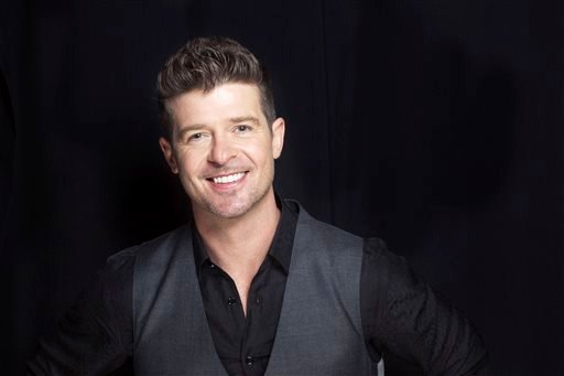 FILE - This Aug. 1, 2013 file photo shows R&B singer-songwriter Robin Thicke in New York. (AP)