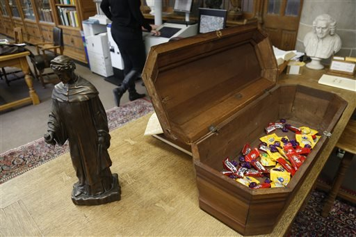 This Oct. 29, 2013, photo taken in Evanston, Ill., shows an actual child's coffin filled with candy at the McCormick Library of Special Collections. (AP Photo/M. Spencer Green)