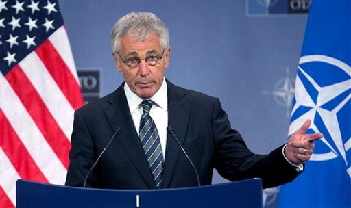 In this Oct. 23, 2013 file photo, Secretary of Defense Chuck Hagel speaks during a media conference after a meeting of NATO defense ministers at NATO headquarters in Brussels.