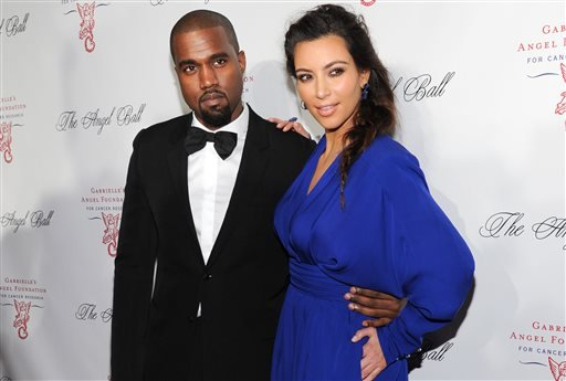 In this Oct. 22, 2012 file photo, singer Kanye West, left, and girlfriend Kim Kardashian attend Gabrielle's Angel Foundation 2012 Angel Ball cancer research benefit at Cipriani Wall Street in New York.