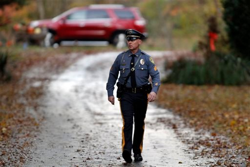 Police gather at a home belonging to the father of the LAX shooting suspect Paul Ciancia in Pennsville N.J. on Friday Nov. 1, 2013. (AP Photo/Joseph Kaczmarek)