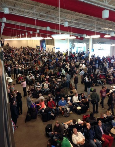 In this photo provided by Tory Belleci which has been authenticated based on its contents and other AP reporting, people wait in Los Angeles International Airport, Friday, Nov. 1, 2013.