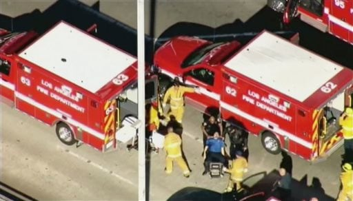 In this video frame grab provided by KTTV Los Angeles, emergency workers prepare to transfer a wounded Transportation Security Administration officer to a waiting ambulance after a shooting in Terminal 3 at Los Angeles International Airport.