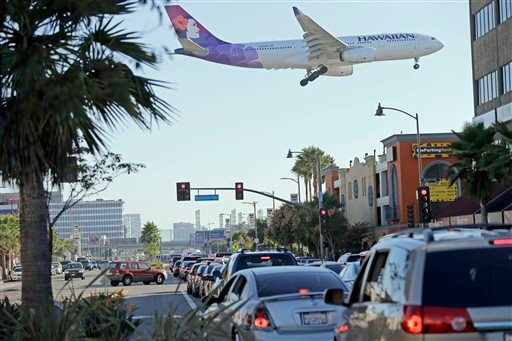 Cars are backed up over a mile as air traffic begins after a shooting at Terminal 3 caused a shutdown at Los Angeles International Airport, Friday, Nov. 1, 2013. A Transportation Security Administration employee was killed and wounding others.